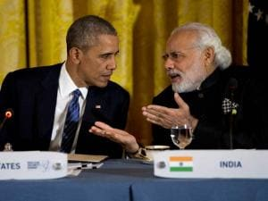 President Barack Obama talks with India's Prime Minister Narendra Modi during a working dinner with heads of delegations of the Nuclear Security Summit in the East Room of the White House,