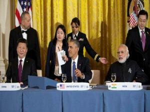 Seated from left, Chinese President Xi Jinping, President Barack Obama, and India's Prime Minister Narendra Modi, gather for a working dinner with heads of delegations of the Nuclear Securi