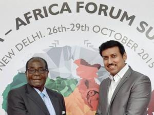 Zimbabwe's President Robert Mugabe is received by Rajyavardhan Singh Rathore