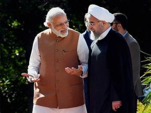 Prime Minister Narender Modi talks with Iranian President Hassan Rouhani, during an official arrival ceremony at the Saadabad Palace in Tehran (2)