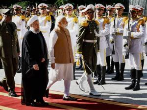 Prime Minister Narender Modi with Iranian President Hassan Rouhani reviews guard of honour at the Saadabad Palace in Tehran, Iran
