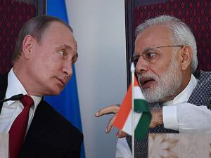 Prime Minister Narendra Modi sharing a word with Russian President Vladimir Putin