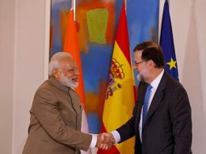 Narendra Modi shakes hands with Spanish Premier Mariano Rajoy at the Moncloa Palace in Madrid