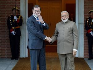 Spanish Premier Mariano Rajoy shakes hands with Narendra Modi at the Moncloa Palace in Madrid