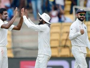 India's R Ashwin with team mates celebrates the wicket of Australia's Mitchel Marsh
