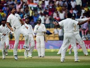 Indian players celebrate after  R Ashwin dismissed Peter Handscomb