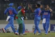 India's Dhawal Kulkarni celebrate with his teammates Suresh Raina, Virat Kohli