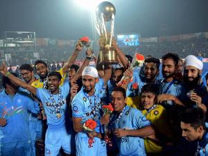 Indian Junior hockey players celebrate with the winning trophy of the Junior World Cup Hockey 2016  after their victory over Belgium