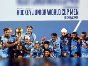 Junior hockey players celebrate with the winning trophy of the Junior World Cup Hockey 2016  after their victory over Belgium
