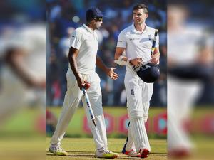 Indian bowler R Ashwin talks to England's batsman James Anderson