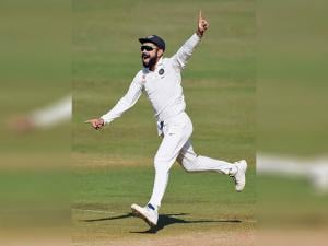 Virat Kohli celebrates the wicket of England batsman Jonny Bairstow