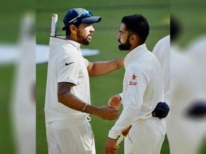 Virat Kohli with Murli Vijay after their victory over England