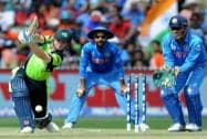Ireland's William Portfield, left, plays a shot as Indian wicketkeeper MS Dhoni