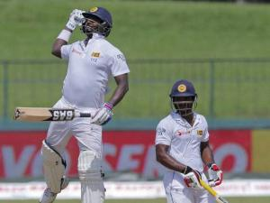 Sri Lanka's Angelo Mathews jumps as he celebrates scoring a hundred