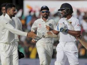 India national cricket team captain Virat Kohli shakes hands with Sri Lanka's  national team player Kumar Sangakkara
