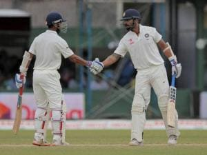 India's Ajinkya Rahane congratulates Murali Vijay for scoring fifty runs