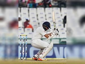 Indian batsman Parthiv Patel ducks a bouncer on the fourth day of the third Test match between India and England in Mohali