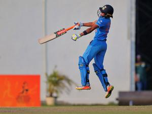 India's Harmanpreet Kaur celebrates after defeating South Africa
