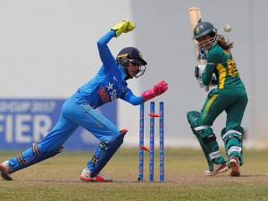 South Africa's Shabnim Ismail looks back as she is bowled out, as India's Sushma Verma celebrates