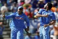 India's Mohammed Shami, celebrates with his teammate M S Dhoni after dismissing West Indies batsman Dwayne Smith