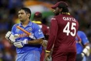 Indian captain M S Dhoni,  is congratulated by West Indies Chris Gayle