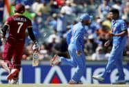 West Indies Marlon Samuels, is run out by India's Virat Kohli