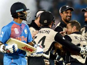 New Zealand bowler Nathan McCullum celebrates the wicket of India's batsman Shikhar Dhawan during the ICC T20 World Cup match