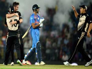 New Zealand players celebrate their_victory against  India during the ICC T20 World Cup match