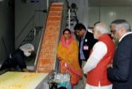 Prime Minister Narendra Modi taking a round after inaugurating India Food Park