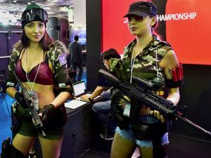 Foreign models representing characters of a particular video game strike a pose at India Gaming Show 2017, at Pragati Maidan