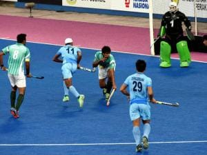 Indian and Pakistani players vie for the ball during the Sultan Azlan Shah Cup Hockey tournament in Ipoh, Malaysia