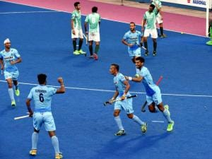 Indian Hockey team players celebrate a goal against Pakistan during the Sultan Azlan Shah Cup Hockey tournament in Ipoh, Malaysia