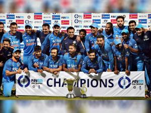 Indian team pose with trophy after winning the series after their third one day international cricket match against England
