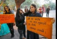 Activists holding placards on the  second anniversary of the deadly gang rape