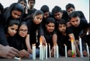Students light candles as they pay tribute to the victim of Delhi gang rape case