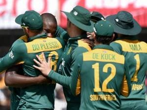 K Rabada of South Africa along with others celebrates wicket of Rohit Sharma