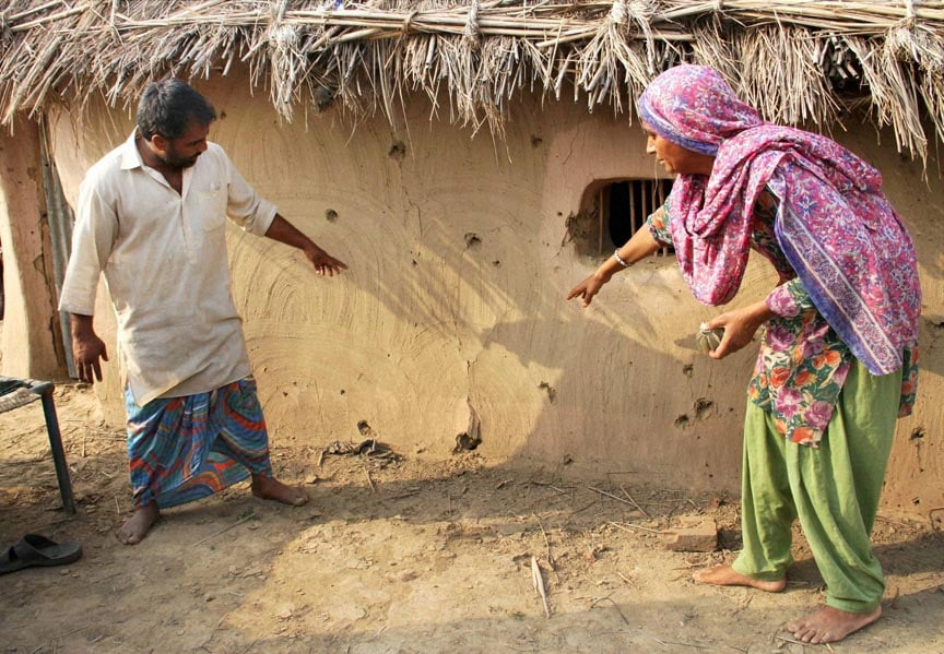 Villagers, showing, bullet, marks, wall, house, firing, Pakistan side, Jeora, village, India-Pakistan, border, RS Pura