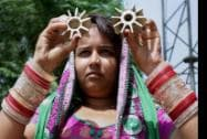 A woman shows mortar shells, allegedly fired on a residential area from Pakistan's side