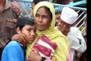 A Bangladeshi boy hugs his mother