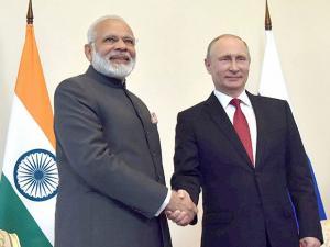 Prime Minister  Narendra Modi shakes hands with Russian President Vladimir Putin