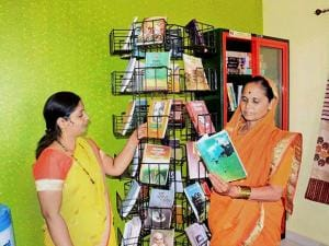 Women checks out books at one of the 25 locations at Bhilar village