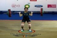 India's Sanjita Khumukcham completes a lift during the 48-kg women's weightlifting