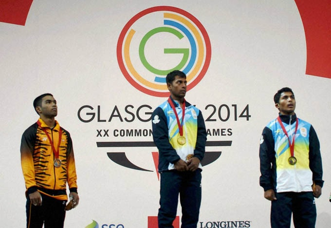 India's, Gold medal winner, Sukhen Dey, Bronze medal winner, Ganesh Mali,  silver medal winner, Malaysia's, Zulhelm MD Pisol, pose, men's, 56 kg, weightlifting, event, Commonwealth Games, Glasgow