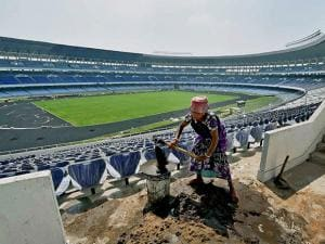 A woman labourer working at Salt Lake Stadium which is in the final stage of renovation work