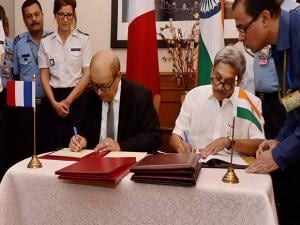 Manohar Parrikar and his French counterpart Jean Yves Le Drian signing the Euro 7.87-billion (Rs 59,000 crore approx) Rafale fighter jets deal