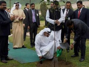 Sheikh Mohammed bin Zayed Al Nahyan, Crown Prince of Abu Dhabi plants a sapling at Mahatma Gandhi's memorial Rajghat in New Delhi