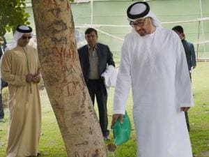 Sheikh Mohammed bin Zayed Al Nahyan, Crown Prince of Abu Dhabi waters a tree at Mahatma Gandhi's memorial Rajghat in New Delhi