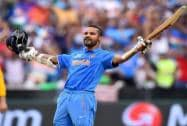ndia's Shikhar Dhawan celebrates after scoring a century against South Africa