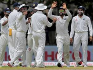 India's captain Virat Kohli celebrates with teammates