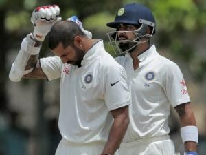 India's Virat Kohli checks the condition of Shikar Dhawan